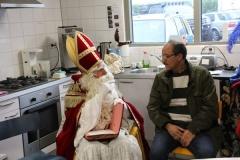 bij Sinterklaas komen